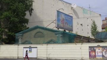 Историческое здание на территории под застройку